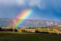 A rainbow over ranch land near Ridgway, Colorado.