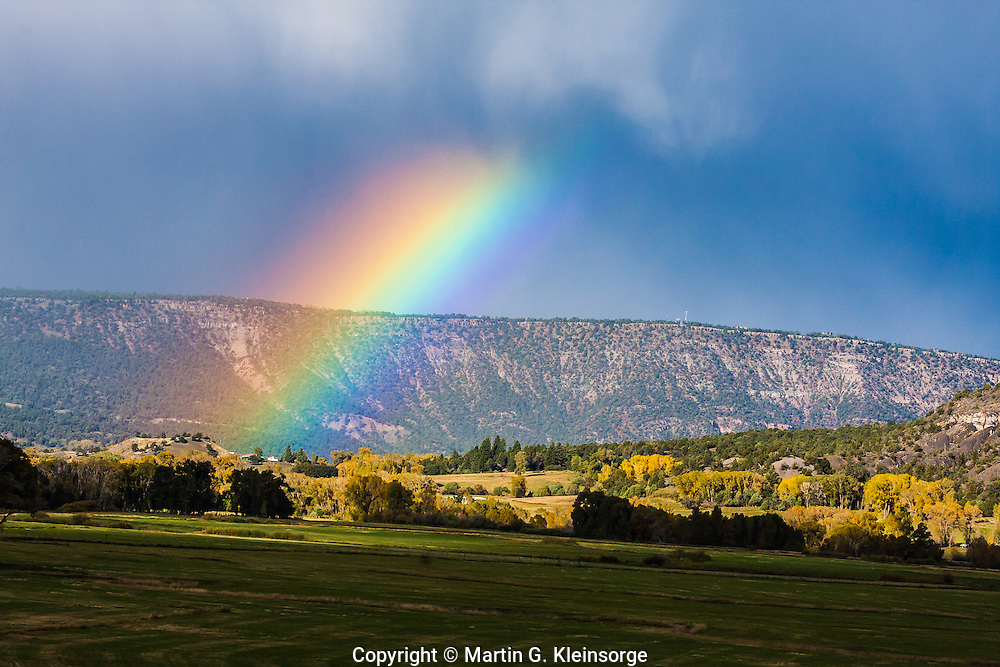 A rainbow over ranch land near Ridgway, Colorado.