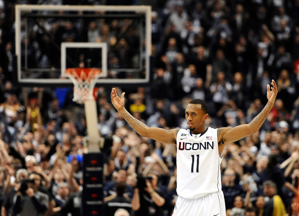 Connecticut's Ryan Boatright rallies the fans during the second half of an NCAA college basketball game against Syracuse in Hartford, Conn., Wednesday, Feb. 13, 2013. (AP Photo/Jessica Hill)