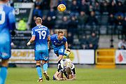 Grimsby Town defender Danny Collins (6) heads ahead of Notts County forward Jonathan Stead (30)  during the EFL Sky Bet League 2 match between Notts County and Grimsby Town FC at Meadow Lane, Nottingham, England on 16 December 2017. Photo by Simon Davies.