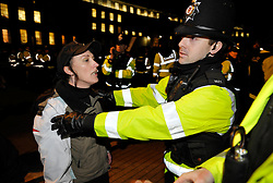 © Licensed to London News Pictures. 07/01/2014; Bristol, UK.  A police officer holds back a member of the English Defence League at an EDL protest on College Green in Bristol against the planning application to convert a former comedy club and concert venue on Bristol's Cheltenham Road into a mosque.  The EDL were confronted and outnumbered by anti-fascist and anti-racist protesters opposing the EDL and police kept the two sides apart.  07 January 2014.<br /> Photo credit: Simon Chapman/LNP