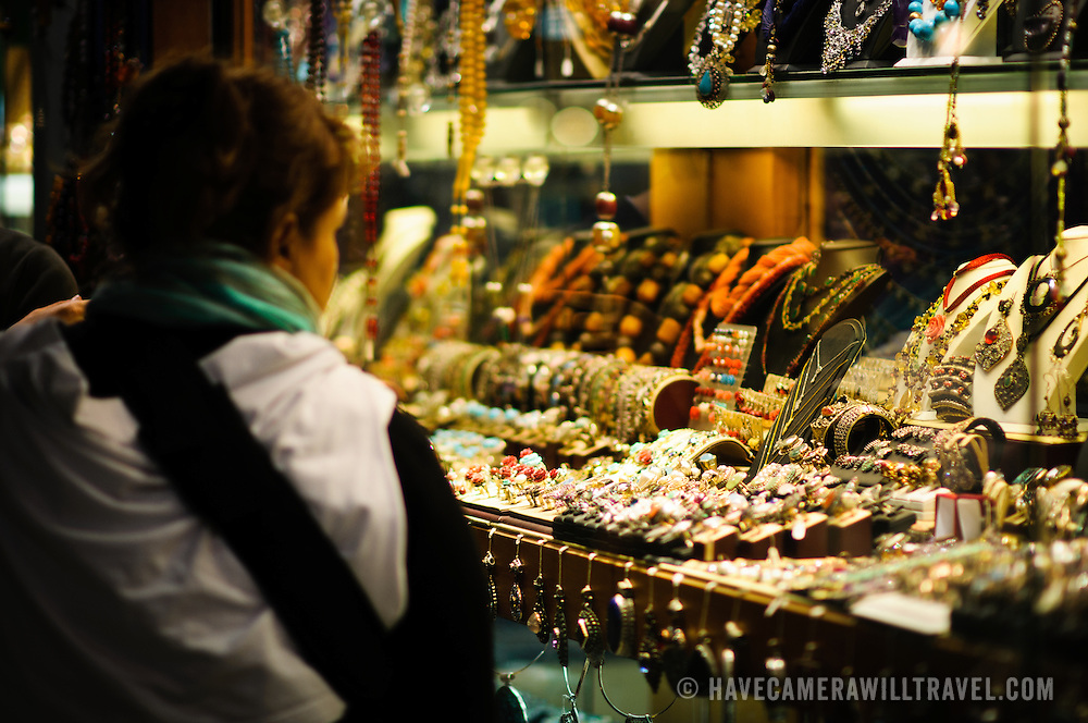 A shopper admires the wares of one of the many jewellery stores inside Istanbul's historic Grand Bazaar