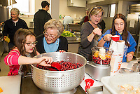 Molly Hazelton, Janet Simmon, Andy Hazelton and Susan Izard make homemade cranberry relish for the annual Hazel Duke Thanksgiving Day dinner at the Congregational Church Wednesday morning.  (Karen Bobotas/for the Laconia Daily Sun)