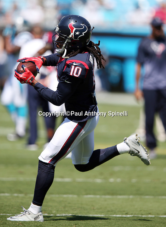 Houston Texans wide receiver DeAndre Hopkins (10) catches a pregame pass while warming up before the 2015 NFL week 2 regular season football game against the Carolina Panthers on Sunday, Sept. 20, 2015 in Charlotte, N.C. The Panthers won the game 24-17. (©Paul Anthony Spinelli)