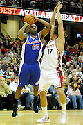 Jan 31, 2010; Cleveland, OH, USA; Los Angeles Clippers guard Mardy Collins (25) tries to shoot over Cleveland Cavaliers forward Anderson Varejao (17) during the second quarter at Quicken Loans Arena. Mandatory Credit: Jason Miller-US PRESSWIRE