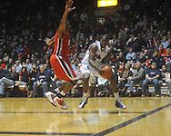 "Ole MIss forward Reginald Buckner (2) drives against Georgia's Jeremy Price (50) at the C.M. ""Tad"" Smith Coliseum in Oxford, Miss. on Saturday, January 15, 2011. Georgia won 98-76.  (AP Photo/Oxford Eagle, Bruce Newman)"