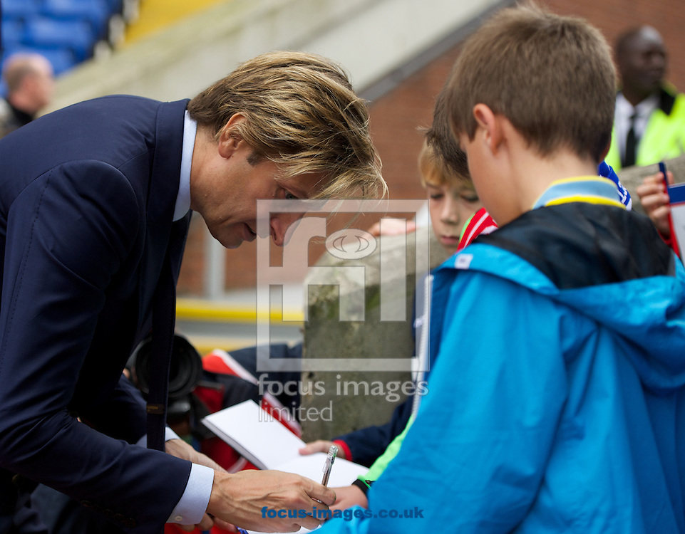 Crystal Palace chairman Steve Parish signs his autograph for a young fan before the Barclays Premier League match at Selhurst Park, London<br /> Picture by Alan Stanford/Focus Images Ltd +44 7915 056117<br /> 18/10/2014