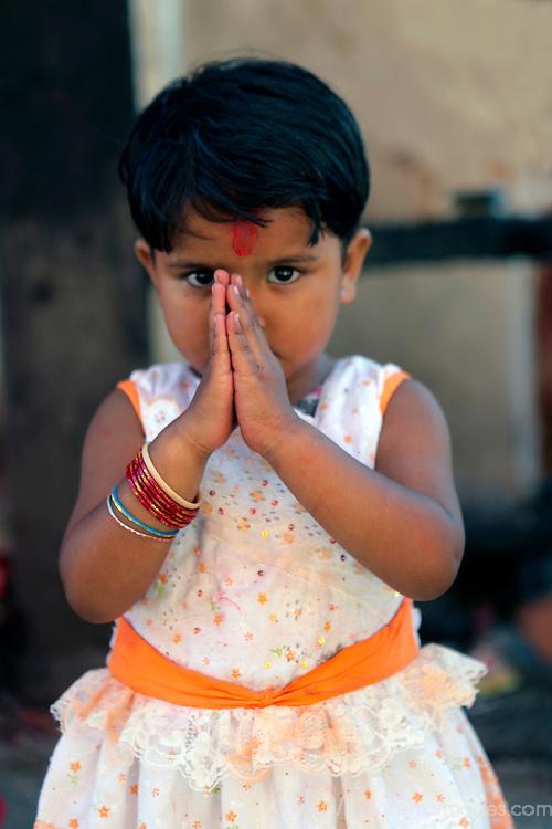Asia, Nepal, Kathmandu. Young girl's Namaste.