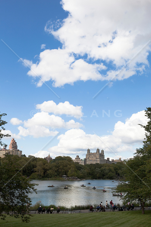 romantic view of New York City overlooking Central Park lake looking West with The Beresford Apartment in the background