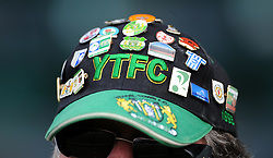 A Yeovil fan with the badges of different Football League clubs on his hat looks on prior to kick off  - Photo mandatory by-line: Harry Trump/JMP - Mobile: 07966 386802 - 21/02/15 - SPORT - Football - Sky Bet League One - Yeovil Town v Gillingham - Huish Park, Yeovil, England.