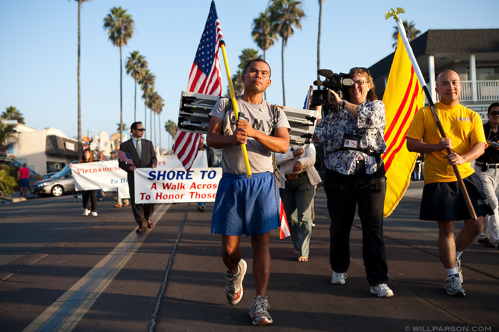 """Sinh Tho Nguyen, a veteran of the Army National Guard, completes his """"Shore to Shore"""" journey on foot in San Diego's Ocean Beach on November 8.  Nguyen, 40, began the 2,500 mile walk on June 10 at Atlantic Beach in Jacksonville, Florida."""