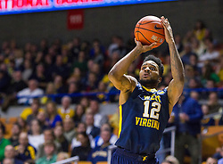 Dec 17, 2015; Charleston, WV, USA; West Virginia Mountaineers guard Tarik Phillip (12) shoots a three pointer during the first half against the Marshall Thundering Herd at the Charleston Civic Center . Mandatory Credit: Ben Queen-USA TODAY Sports
