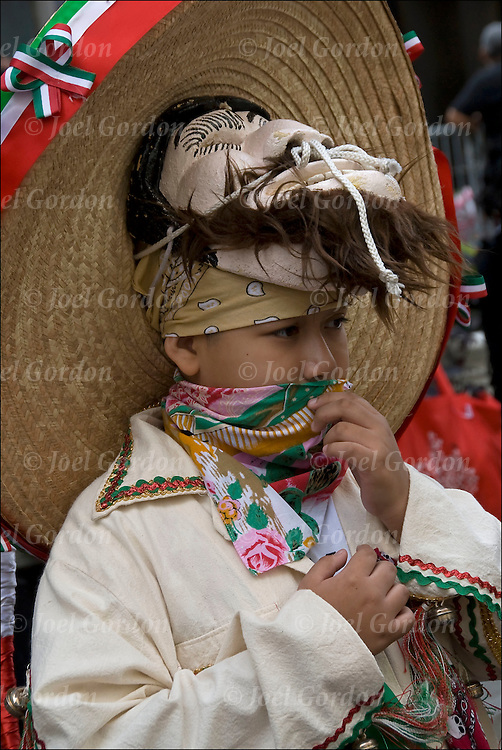 Mexican Day parade in New York City, second generation Mexican American boy before the start of the parade, shows his ethnic pride dressed in traditional folk costume, sombrero and mask.
