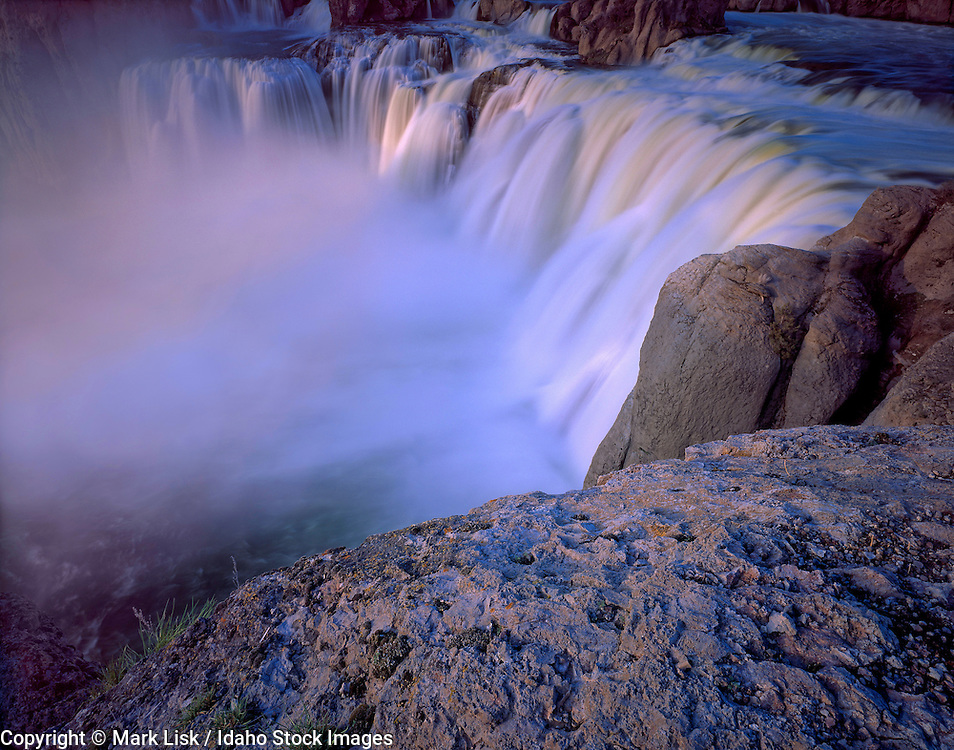 Idaho. The Snake River pours over huge basalt cliffs at Shoshone Fall near Twin Falls.