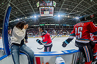 KELOWNA, CANADA - OCTOBER 27: Carsen Twarynski #18 of the Kelowna Rockets skates past Cal Foote #25 on the bench and celebrates a second period goal against the Tri-City Americans on October 27, 2017 at Prospera Place in Kelowna, British Columbia, Canada.  (Photo by Marissa Baecker/Shoot the Breeze)  *** Local Caption ***
