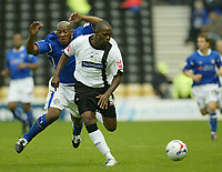 Photo: Aidan Ellis.<br /> Derby County v Leicester City. Coca Cola Championship. 01/10/2005.<br /> Derby's Stern John gets in front of Leicester's Dion Dublin