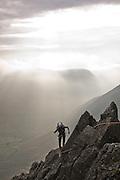 Climbers on Needle Ridge, Great Gable, overlooking Wasdale, Lake District, Cumbria, England, UK