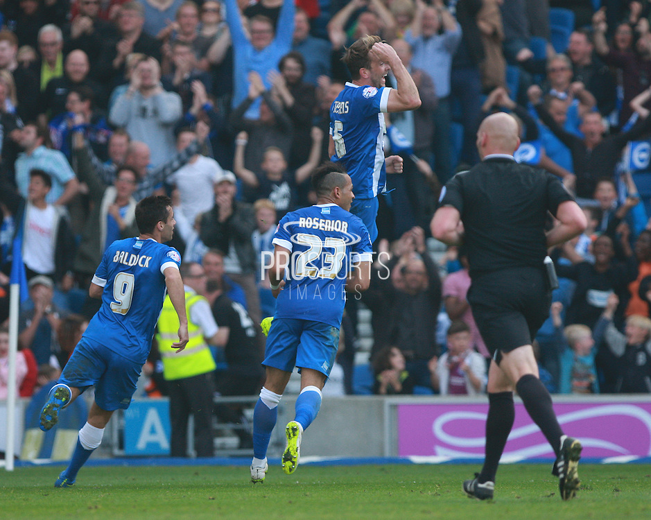 Brighton central midfielder Dale Stephens celebrates after scoring the equaliser during the Sky Bet Championship match between Brighton and Hove Albion and Cardiff City at the American Express Community Stadium, Brighton and Hove, England on 3 October 2015. Photo by Bennett Dean.