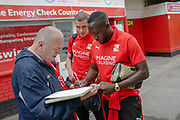 Swindon Town midfielder Toumani Diagouraga (20) and Swindon Town defender Sid Nelson (5) sign autographs before the EFL Sky Bet League 2 match between Swindon Town and Bury at the County Ground, Swindon, England on 15 September 2018.