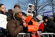 Linda Walker, of Bayshore, New York, (orange jacket) celebrates as Barack Obama is sworn in as president of the United States.