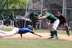 11 May 2013:  Mike Kane dives back for first bee on a pick off throw to Kevin Callahan during an NCAA division 3 College Conference of Illinois and Wisconsin (CCIW) Pay in Baseball game during the Conference Championship series between the North Park Vikings and the Illinois Wesleyan Titans at Jack Horenberger Stadium, Bloomington IL