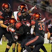 24 November 2018: San Diego State Aztecs safety Tariq Thompson (14) recovers a fumble by Hawaii Warriors running back Miles Reed (26) in the fourth quarter. in the fourth quarter. The Aztecs closed out the season with a 31-30 overtime loss to Hawaii at SDCCU Stadium.