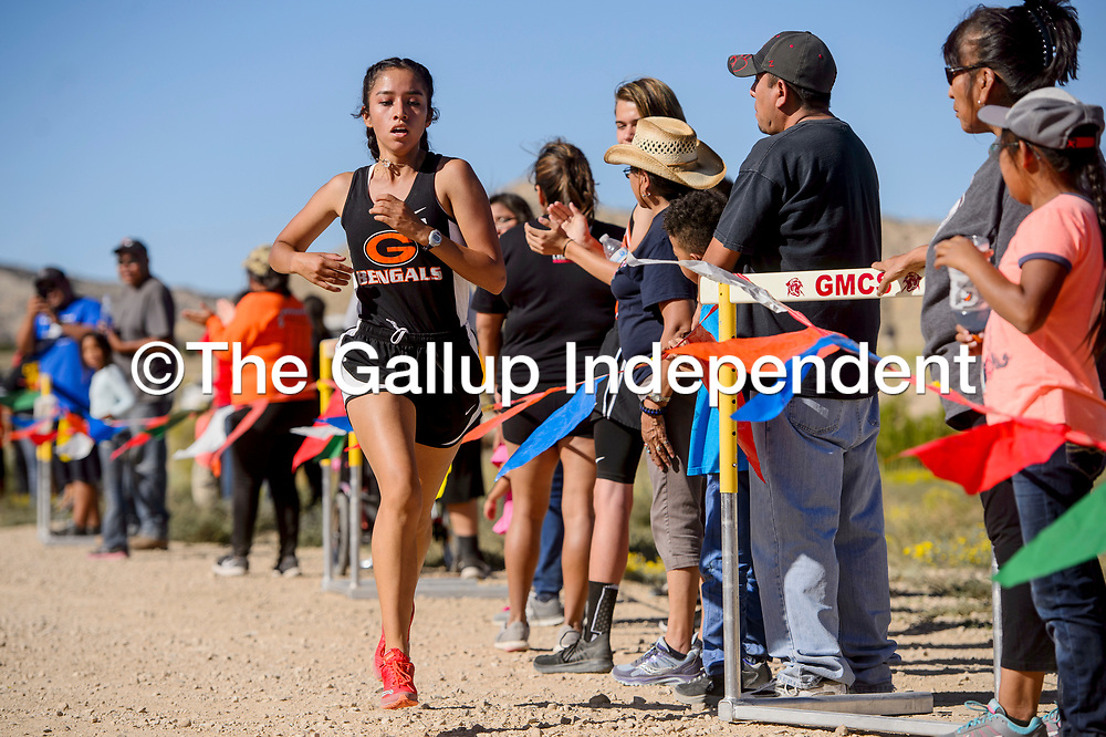Gallup Bengal Jessica Ramirez strides to a first place finish in the girls varsity race of the Tohatchi Cross Country meet in Tohatchi Friday.