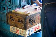 A man prepares fish fillets in Tsukiji fishmarket, Tokyo