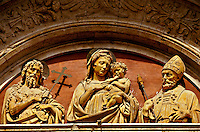 Sant' Agostino Church (terra cotta relief of Madonna and child above door), St. John the Baptist on left, Virgin Mary with Jesus and St. Agostino (right), Montepulciano, Tuscany, Italy