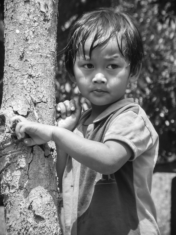 The Little Kid, Thailand, by Zong. <br /> <br /> About the photographer: Zong is 2 years hold and has a Burmese ad Kayan heritage but was <br /> born in Thailand. She enjoys playing volleyball. Besides, she likes experimenting with detail and zoom in her photographs. Zong&rsquo;s mother came to Thailand by request of the armed militant group &ndash; the KNPP. In Kayan culture, the long neck rings are beautiful, but both Zong and her family have suffered due to &ldquo;long neck tourism.&rdquo;