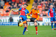 Charlie Trafford (#24) of Inverness Caledonian Thistle FC and Pavol Safranko (#14) of Dundee United FC contest the ball during the William Hill Scottish Cup quarter final match between Dundee United and Inverness CT at Tannadice Park, Dundee, Scotland on 3 March 2019.