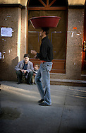 ISTANBUL, TURKEY - 22-11-2003: A man walking with a tray on top of his head.
