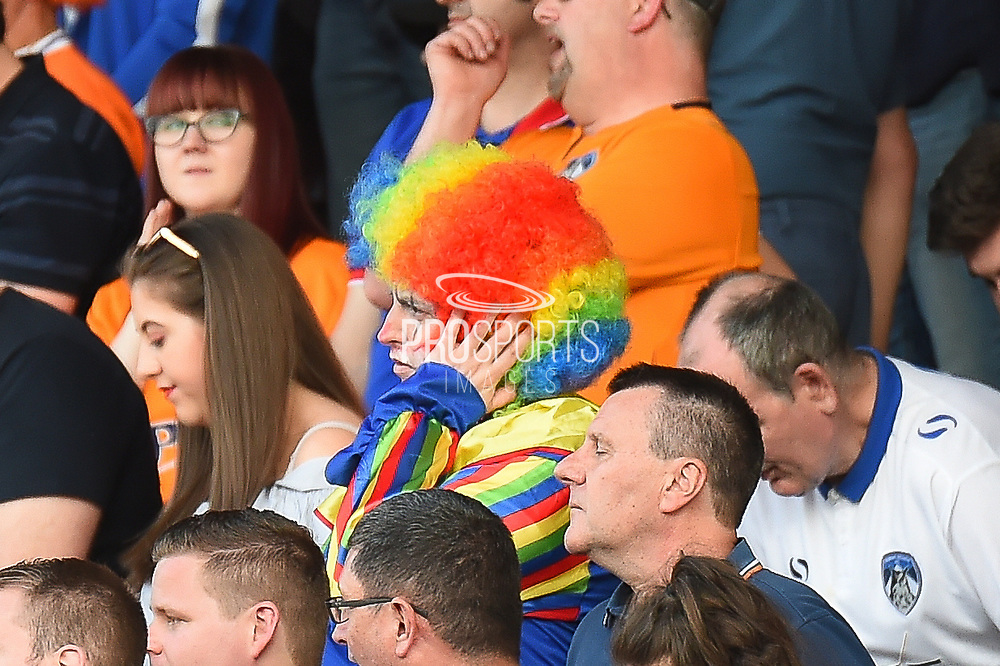 """Tears of a Clown"" A female Oldham fan dressed in a Clown suit looks dejected during the EFL Sky Bet League 1 match between Northampton Town and Oldham Athletic at Sixfields Stadium, Northampton, England on 5 May 2018. Picture by Dennis Goodwin."