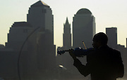 Mohammad Bilal plays his violin along the waterfront on the second anniversary of the terrorist attack on the World Trade Center.