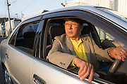 Shinji Aoyama, a retired man who drives a car for the Japan Car Sharing Association in Ishinomaki, Japan.