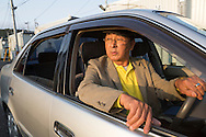 Shinji Aoyama, a retired man who drives a car for the Japan Car Sharing Association in Ishinomaki, Japan.