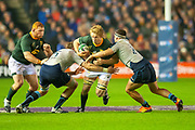 Pieter-Steph du Toit (#7) (DHL Western Province) of South Africa is tackled by Jonny Gray (#5) (Glasgow Warriors) of Scotland and Stuart McInally (#2) (Edinburgh) of Scotland during the Autumn Test match between Scotland and South Africa at the BT Murrayfield Stadium, Edinburgh, Scotland on 17 November 2018.