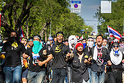 01 DECEMBER 2013 - BANGKOK, THAILAND: Thai anti-government protestors march towards police positions in Bangkok. Thousands of anti-government Thais confronted riot police at Phanitchayakan Intersection, where Rama V and Phitsanoluk Roads intersect, next to Government House (the office of the Prime Minister). Protestors threw rocks, cherry bombs, small explosives and Molotov cocktails at police who responded with waves of tear gas and chemical dispersal weapons. At least four people were killed at a university in suburban Bangkok when gangs of pro-government and anti-government demonstrators clashed. This is the most serious political violence in Thailand since 2010.    PHOTO BY JACK KURTZ