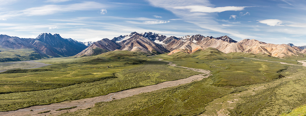 Composite panorama of mountains of Alaska Range from Polychrome Pass overlook in Denali National Park in Southcentral Alaska. Summer. Morning.