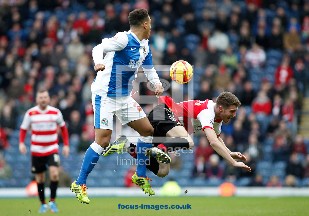 Picture by Michael Sedgwick/Focus Images Ltd +44 7900 363072<br /> 11/01/2014<br /> Adam Henley of Blackburn Rovers and James Husband of Doncaster Rovers in action during the Sky Bet Championship match at Ewood Park, Blackburn.