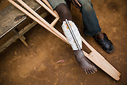 Mumbere Grace, 16, a member of the mai-mai militia, sits on a beach outside the general hospital in the town of Kayna, Eastern Democratic Republic of Congo, on Thursday December 11, 2008. Mumbere, who has been a member of the mai-mai for three years already, was injured by a bullet during recent fighting against CNDP rebels.