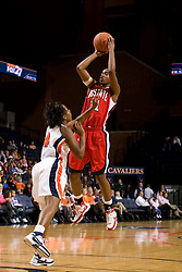 N.C. State guard Sharnise Beal (31) shoots over Virginia guard Enonge Stovall (40).  The Virginia Cavaliers faced NC State Wolfpack women's basketball team at the John Paul Jones Arena in Charlottesville, VA on February 1, 2008.