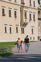 People walking by Wawel Cathedral and Golden Sigismund's Chapel in Krakow Poland