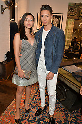 NAT WELLER and LEAH WELLER at a party to celebrate the launch of the first European John Varvatos Store, 12-13 Conduit Street, London held on 3rd September 2014.