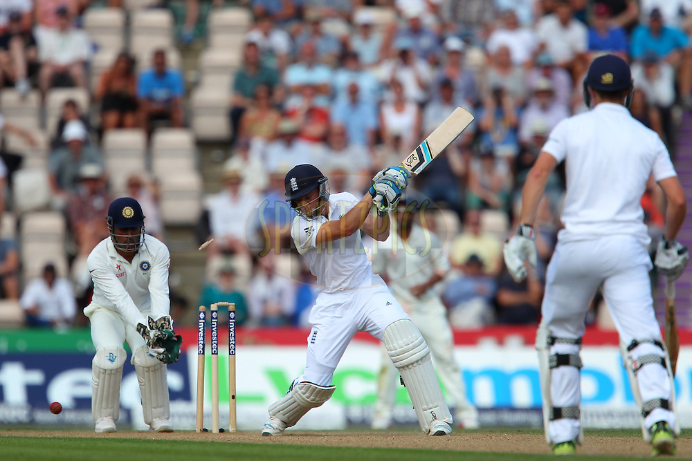 Jos Buttler of England  is bowled by Ravindra Jadeja of India during day two of the third Investec Test Match between England and India held at The Ageas Bowl cricket ground in Southampton, England on the 28th July 2014<br /> <br /> Photo by Ron Gaunt / SPORTZPICS/ BCCI