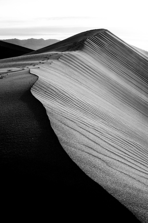 Sand dunes in Death Valley National Park, California. Black and white photograph.