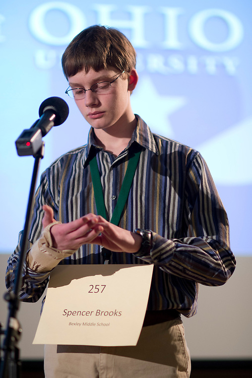 Spencer Brooks writes out a word on his hand to help him remember the correct spelling during the Columbus Metro Regional Spelling Bee Regional Saturday, March 16, 2013. The Regional Spelling Bee was sponsored by Ohio University's Scripps College of Communication and held in Margaret M. Walter Hall on OU's main campus.