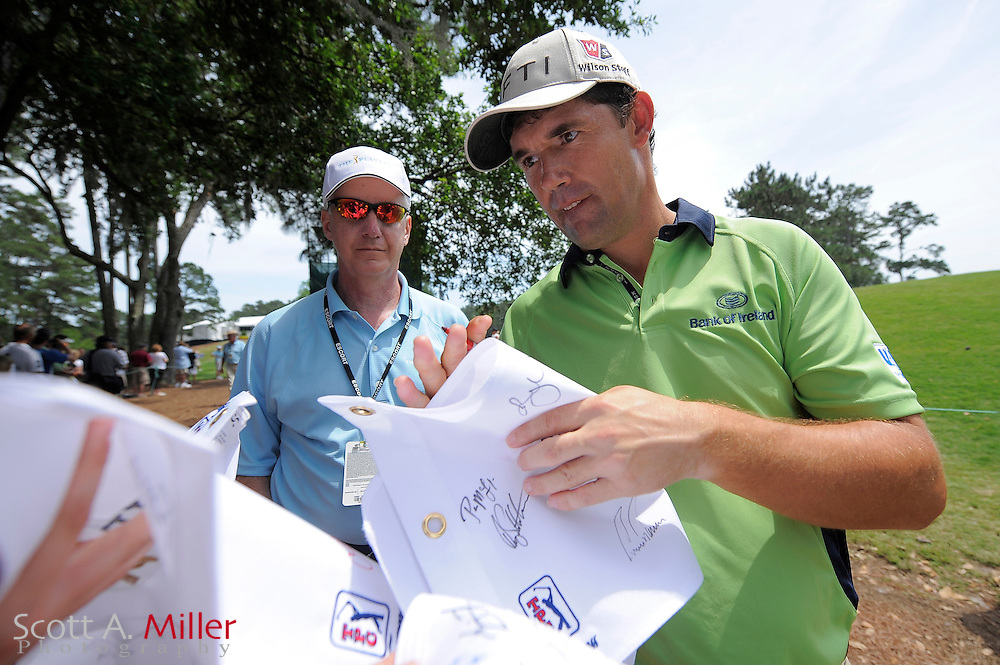Padraig Harrington of Ireland signs autographs during a practice round at TPC Sawgrass on May 6, 2009 in Ponte Vedra Beach, Florida.     ©2009 Scott A. Miller