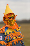 A costumed reveler during the Faquetigue Courir de Mardi Gras chicken run on Fat Tuesday February 17, 2015 in Eunice, Louisiana. The traditional Cajun Mardi Gras involves costumed revelers competing to catch a live chicken as they move from house to house throughout the rural community.