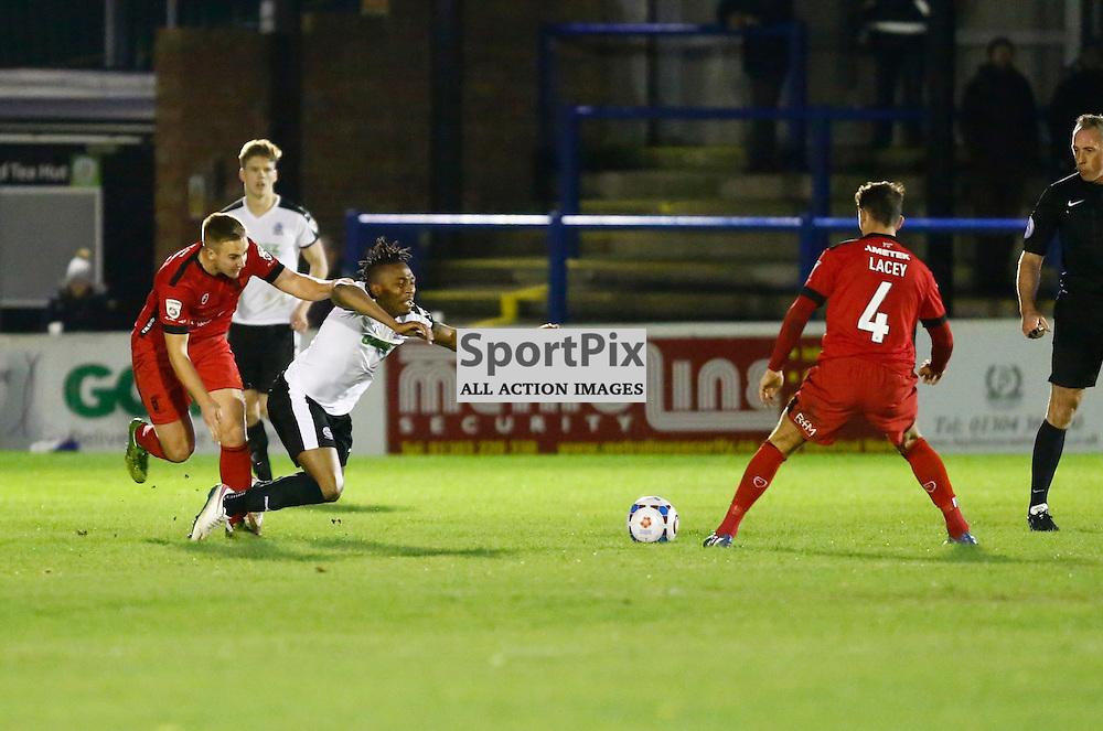 Dover's defender Aswad Thomas (21) is sent crashing to the deck. Dover Athletic v Barrow. Vanarama National League. 10  November 2015. (c) Matt Bristow | SportPix.org.uk